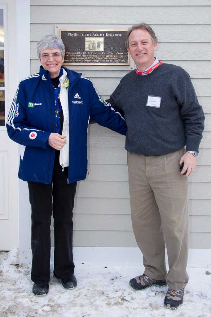 Phyllis Jalbert and Andy Shepard show off the Phyllis Jalbert Athlete Residence, which already houses two biathletes on the Maine Winter Sports Center team.