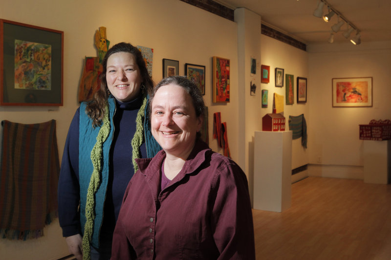 Deb Fahy, right, Harlow Gallery's executive director, and Nancy Barron, assistant director.