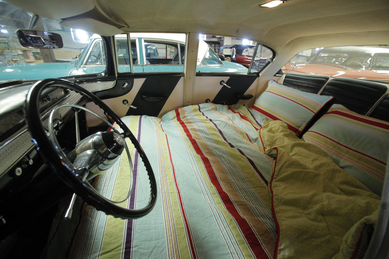 The front seats of this 1957 Nash Ambassador Custom fold down to create a sleeping area. The sleeping feature was marketed as a way for travelers to save money on road trips.