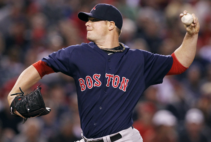 Boston Red Sox pitcher Jon Lester delivers against the Los Angeles Angels Friday night in Anaheim, Calif.