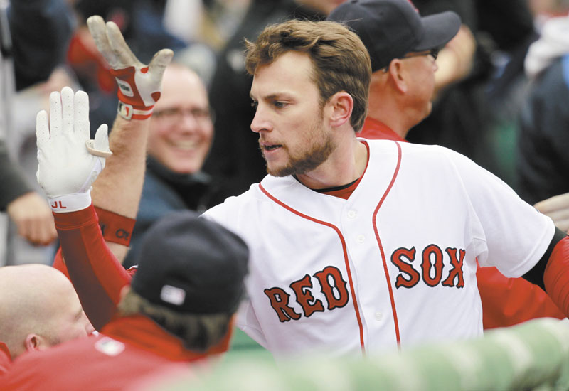 Boston Red Sox shortstop Jed Lowrie celebrates after hitting a two-run home run in the second inning of the Red Sox' 4-1 win over the Toronto Blue Jays on Saturday at Fenway Park in Boston.