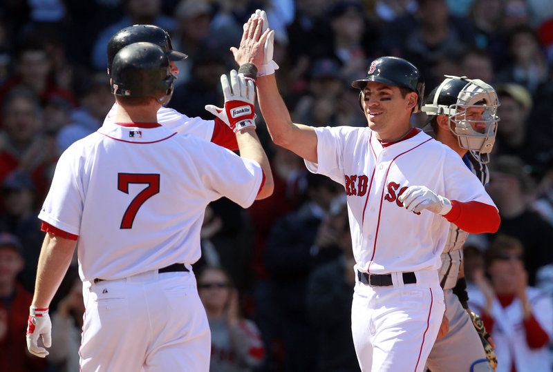 Jacoby Ellsbury, right, is greeted by J.D. Drew, front left, and Jarrod Saltalamacchia after hitting a three-run homer.
