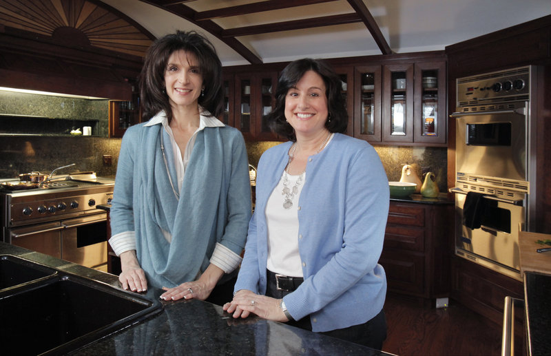 Marjorie Ferris of Fine Living Events, right, helped organize the Falmouth Kitchen & Tasting Tour, which takes place May 6 and 7. The tour includes the kitchen in the home of Tanya Preston, left.