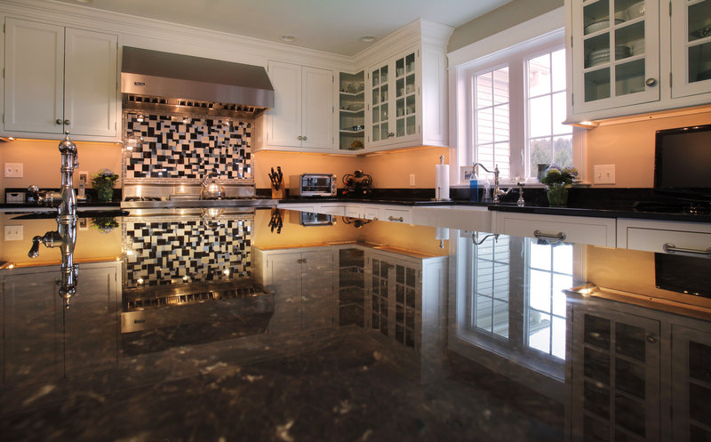 Sarah Steinberg's vocation as a designer who specializes in kitchens and baths is evident in her kitchen, which is reflected in the expansive granite top of the central island. The room is part of an upcoming tour to benefit the Preble Street Maine Hunger Initiative.