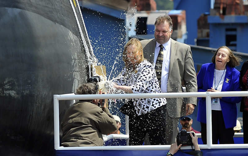 Maureen Murphy, Ship sponsor and mother of Michael Murphy, christens the Michael Murphy DDG 112 at Bath Iron Works with a bottle of champaigne today.