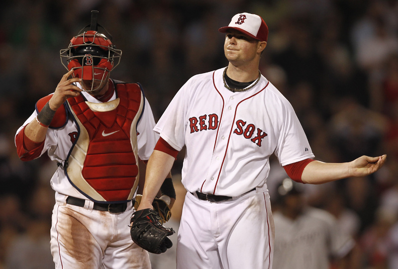 Boston Red Sox starting pitcher Jon Lester throws his gum after giving up a two-run single to Chicago White Sox's Alexei Ramirez during the sixth inning at Fenway Park in Boston on Monday. At left is catcher Jarrod Saltalamacchia.