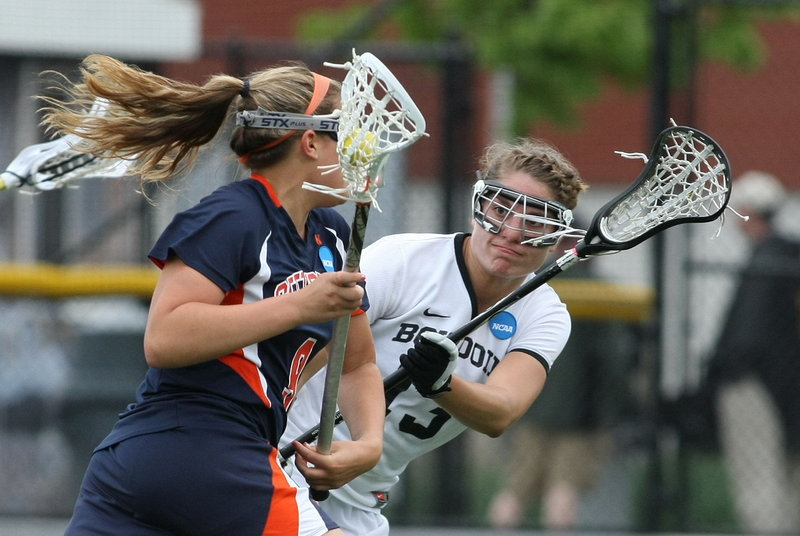 Ingrid Oelschlager of Bowdoin defends against Gettysburg's Hannah Church during the NCAA Division III women's lacrosse final Sunday at Garden City, N.Y. The Polar Bears fell short in their bid for their first NCAA title, losing 16-5.