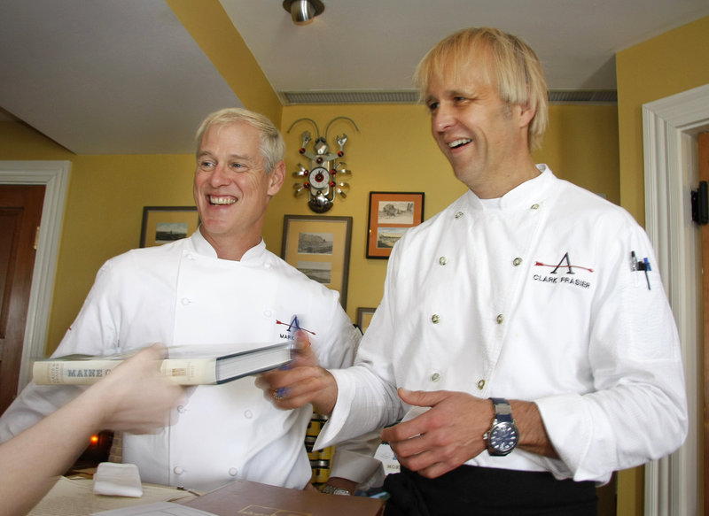 "Chefs Mark Gaier and Clark Frasier sign copies of their new cookbook, ""Maine Classics: More Than 150 Delicious Recipes From Down East,"" at a recent book launching celebration at their MC Perkins Cove in Ogunquit."