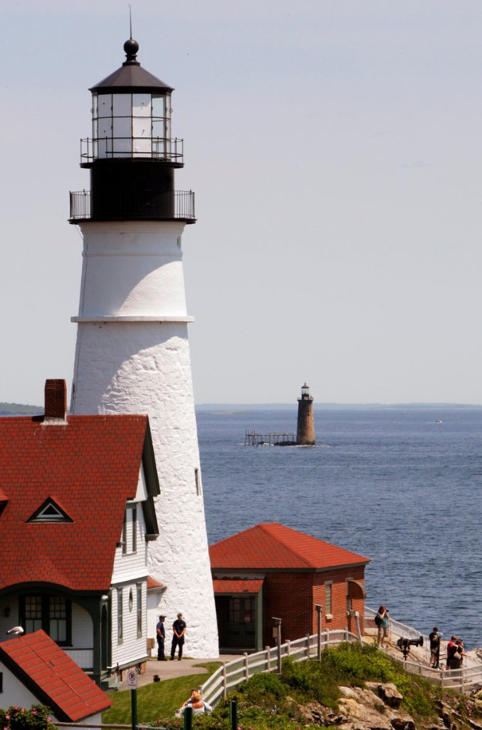 Ram Island Ledge Light, built in 1903-1905, is seen about a mile offshore from its more famous cousin, Portland Head Light in Cape Elizabeth, which is in the foreground.