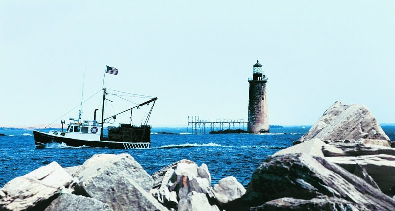 A fishing boat passes Ram Island Ledge Light entering Portland Harbor. New rules harm independent fishermen, a reader says.