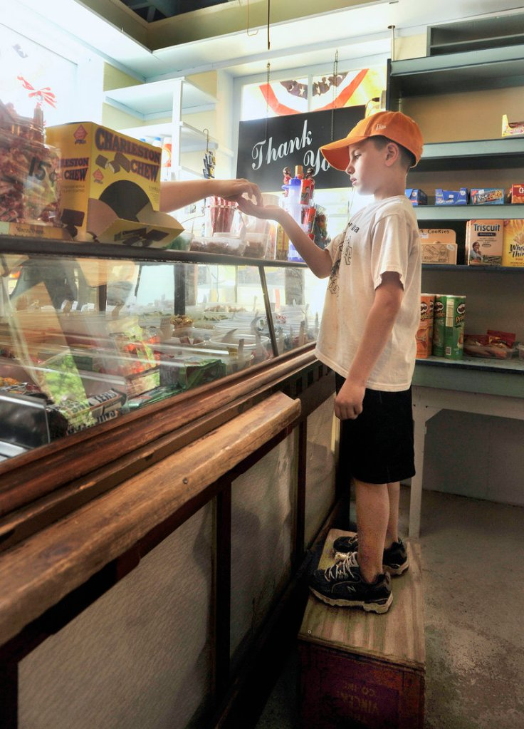 Griffin Foster, 7, of Connecticut pays for his candy.