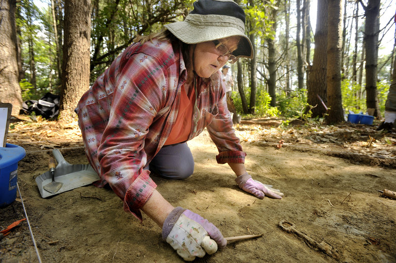 Mary Cook of Orrs Island unearths a key Tuesday during the first archaeological field school hosted by the Freeport Historical Society on Grant's Point. The dig focuses on an area where Abraham and Susannah Grant lived in the late 1700s and early 1800s.