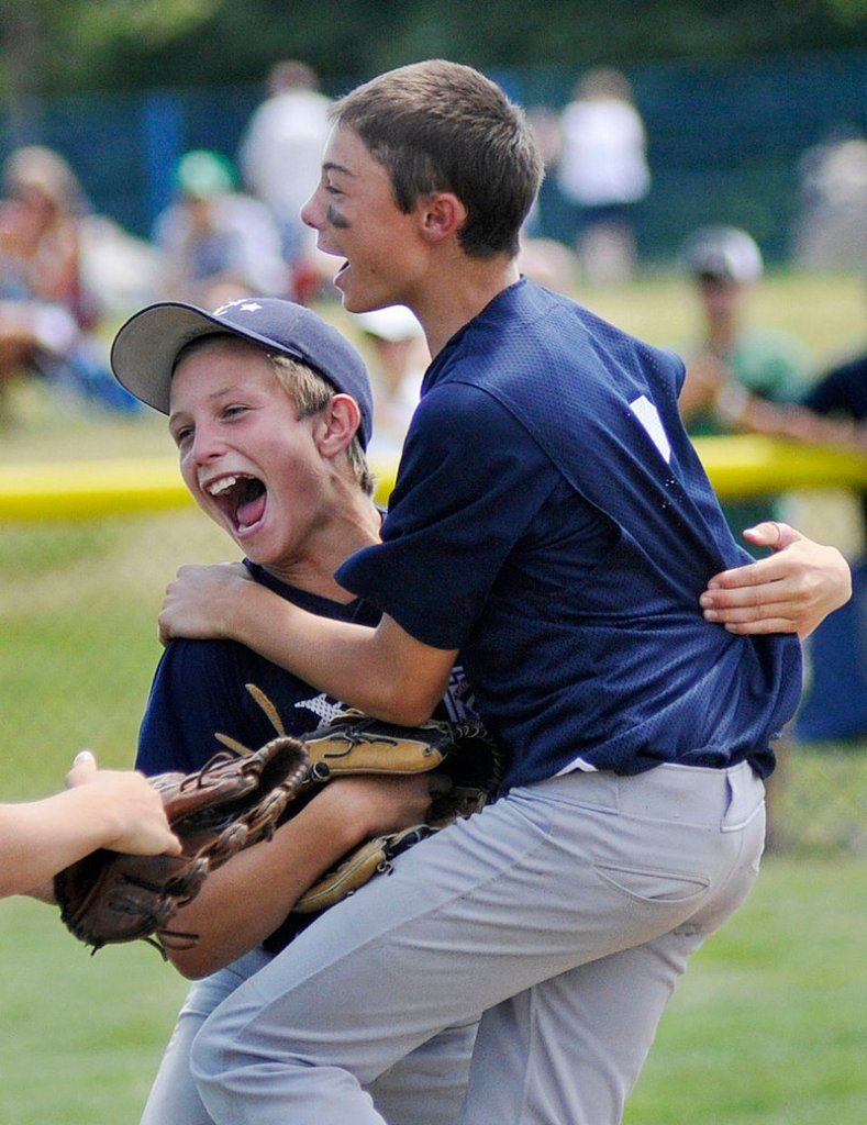 Noah Pellerin, right, and Jack Snyder lead the celebration Saturday after Snyder caught a fly to right, ending the game and giving Yarmouth a 6-3 victory against York in eight innings in the Little League state final at Payson Park.
