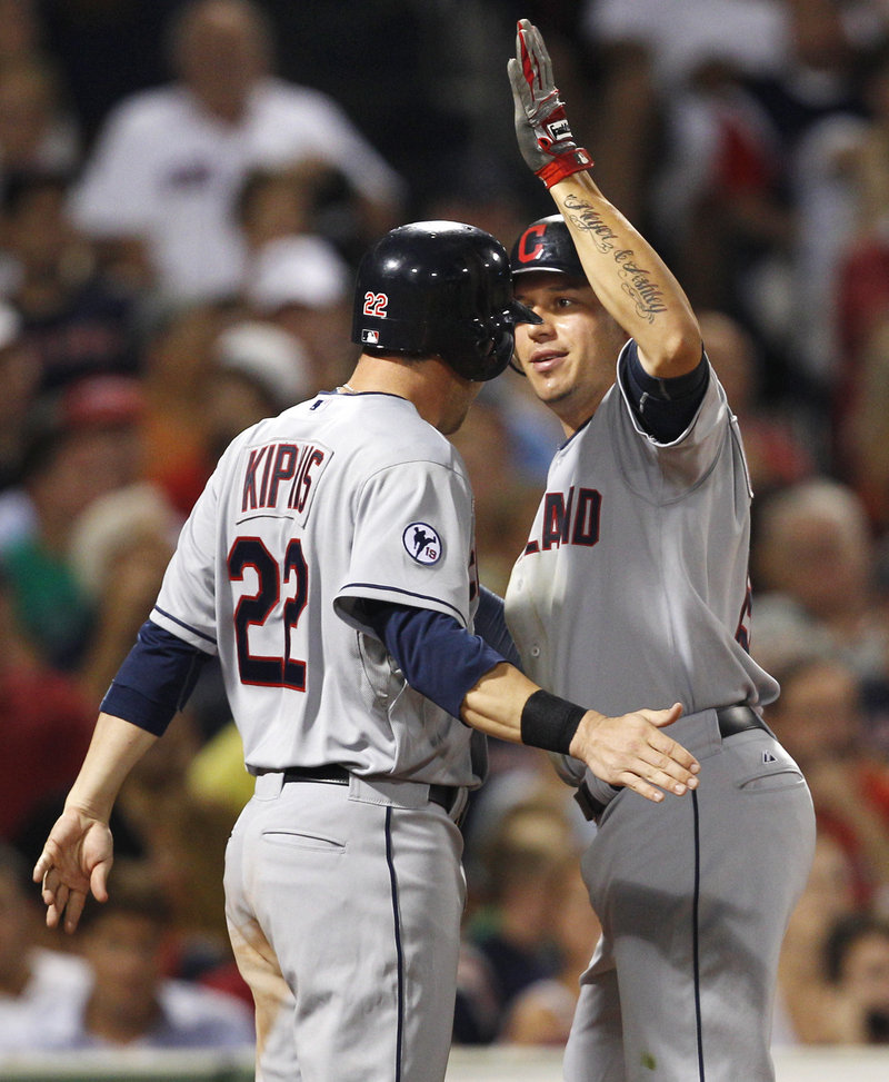 Jason Kipnis congratulates Asdrubal Cabrera after Cabrera's hit in the eighth inning is ruled a two-run homer after a video review.