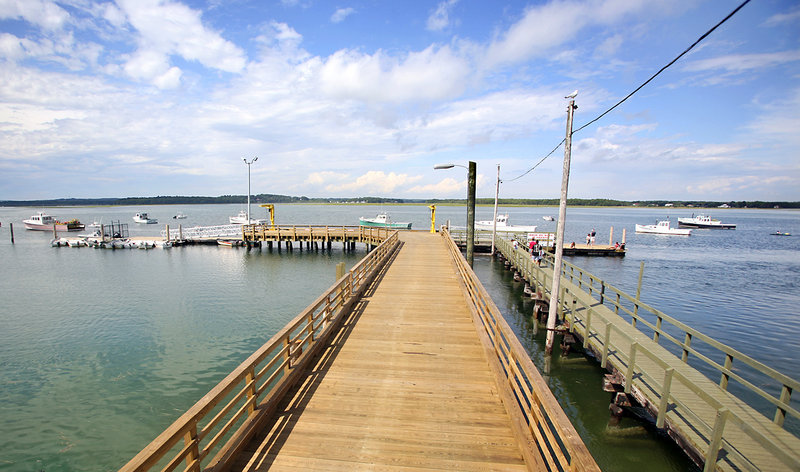 This pier at Pine Point in Scarborough, built in 2011 for $800,000, is located behind the Pine Point Fisherman's Co-op that is under contract to a pair who own other businesses nearby. The co-op has been the center of the town's lobster and soft-shell clam industry.