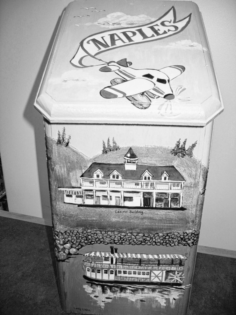 Bird, bat and butterfly houses will be auctioned Saturday to benefit the Naples Public Library. Andrea Dacko painted this bat house with scenes of the Naples Causeway.