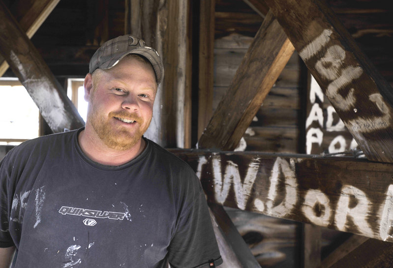 """Andrew Wilcox and his crew will add their names to the graffiti-like register hidden within the steeple of the Old Meeting House in Yarmouth, pictured below. """"I guess it's kind of a tradition,"""" he said Wednesday. """"I sign every steeple we do. Just put my initials and the date."""""""