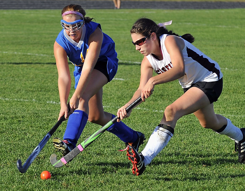Kristina Morton of Lake Region, left, and Julia Maine of Greely compete for the ball Monday during Greely's 3-1 victory at home in field hockey. The Rangers improved their record to 8-3. Lake Region is 4-4-2.