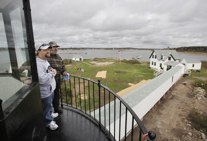 Martin Cain, right, and his son, Marty, take in the view from the Goat Island Lighthouse on Wednesday. Martin was the lighthouse keeper in 1978 when a storm flooded the island and washed away the covered walkway between the keepers' quarters and the lighthouse. The walkway was replaced as part of a restoration of the lighthouse and other buildings on the island.