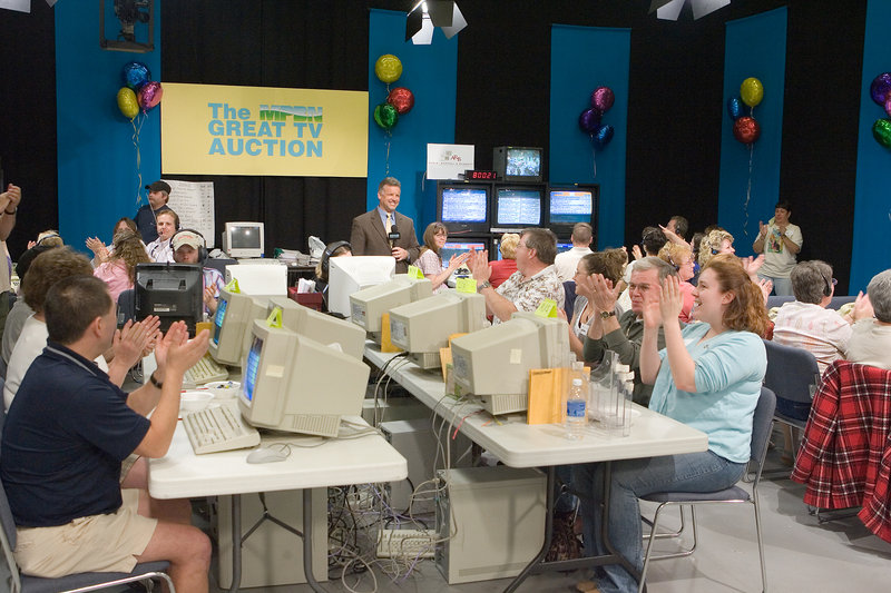 Volunteers and other workers cheer during The MPBN Great TV Auction. Network officials say the costs of the auction ate up about two-thirds of the event's revenue and they are pursuing alternative fundraising methods.