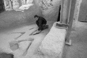 ISRAEL'S Antiquities Authority archeologist Eli Shukron sweeps marks carved in the bedrock in an archeological excavation in the city of David near Jerusalem's Old City. The mysterious stone carvings made thousands of years ago and recently uncovered in an excavation underneath Jerusalem have archaeologists stumped.