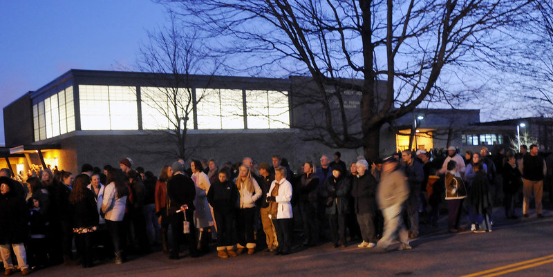 A crowd in front of Cheverus High School in Portland awaits the wreath convoy on Sunday afternoon. At a later ceremony inside the school, speakers reminded the audience about the Wreaths Across America motto: Remember, Honor, Teach.