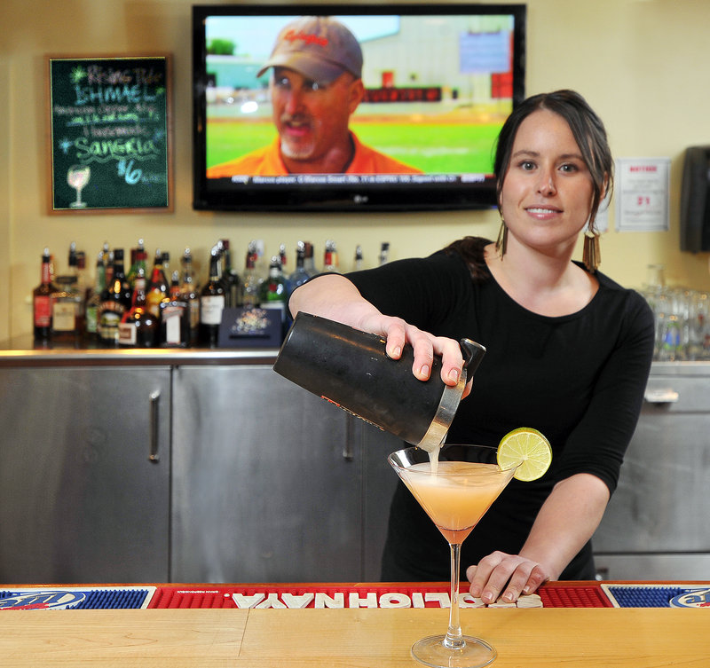 Colleen Foley, bar manager at the Snow Squall, makes one of its many specialty martinis, a Grapefruit Martini. The reviewer enjoyed a Lavender French 75, which includes locally made mead.
