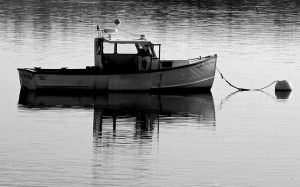 A LOBSTER BOAT bobs at its mooring on the Sheepscot River in Wiscasset on New Year's Day, Sunday.
