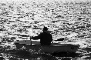A MAN rows his skiff in choppy waters at Popham in Phippsburg.