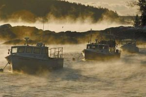SEA SMOKE RISES from the water in Cundy's Harbor on Sunday just after dawn.