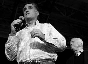 REPUBLICAN PRESIDENTIAL candidate and former Massachusetts Gov. Mitt Romney, left, campaigns with Sen. John McCain, R-Ariz., during a town hall style meeting in Manchester, N.H., on Wednesday. Romney accepted an endorsement from McCain, the 2008 Republican presidential nominee, as he pushed for an overwhelming victory in Tuesday's New Hampshire primary.