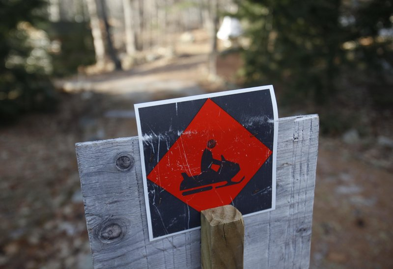 A snowmobile trail sign in Bridgton marks a snow-less trail. As of Thursday, only 19 percent of the nation was covered in snow, less than half the average over the past five years.