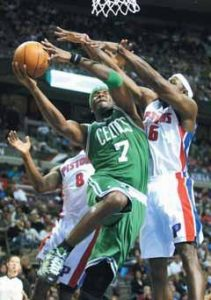 BOSTON CELTICS' Jermaine O'Neal (7) shoots between Detroit Pistons' Ben Gordon (8) and Ben Wallace (6) in the first half of an NBA basketball game on Sunday in Auburn Hills, Mich.