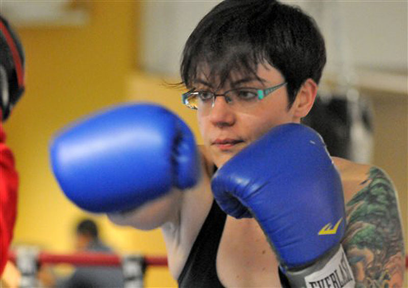 In this Feb. 17 photo, Kerri Lewis, 31, of Worcester, Mass. trains at the Boys & Girls Club in Worcester to stay in shape. (AP Photo/Worcester Telegram & Gazette, John Ferrarone)