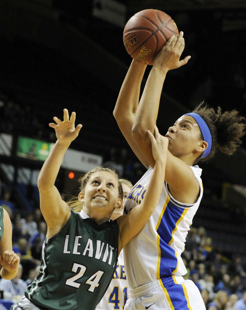Tiana-Jo Carter, who finished with 25 rebounds for Lake Region, hauls down the ball over Kelly Pomerleau of Leavitt during the Lakers' 59-54 overtime victory at the Cumberland County Civic Center.
