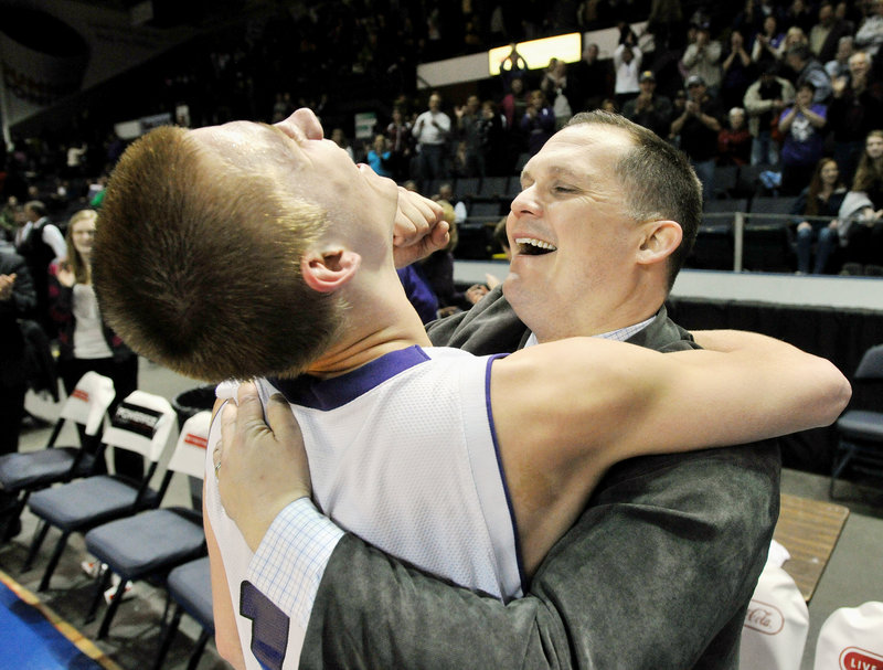Pat Green, left, celebrates with Coach Dan LeGage after hitting a buzzer-beating shot to give Deering a 45-42 victory over Bonny Eagle in the Western Class A final at the Cumberland County Civic Center.