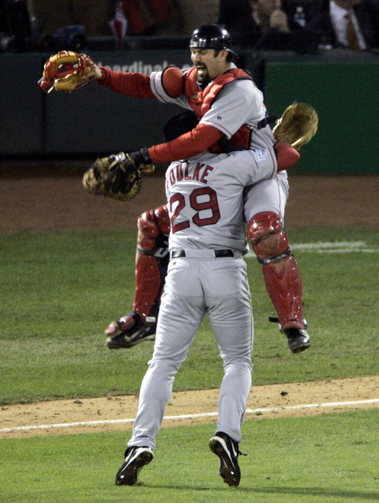 The Curse is over … Red Sox catcher Jason Varitek leaps into the arms of closer Keith Foulke after Boston swept St. Louis in the 2004 World Series to end an 86-year championship drought.