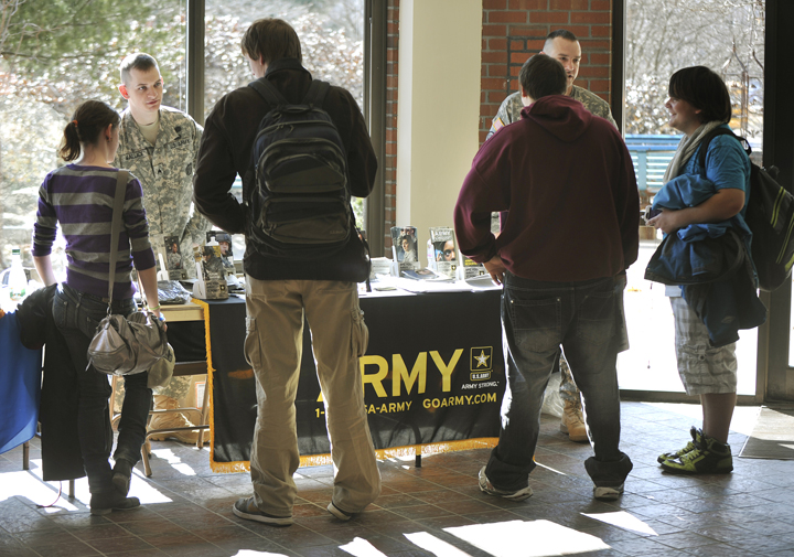 U.S. Army recruiters Sgt. Stephen Wallace, lefr, and Sfc. Brandon Didier talk with PATHS students during the job fair.