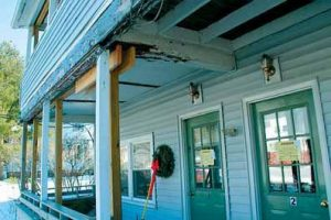 SEVEN RESIDENTS at 77 Pleasant St. were evicted by the town of Brunswick in Januar y. After nearly two years of attempted repairs to a rotting porch in front of the building, town officials decided to condemn the property.