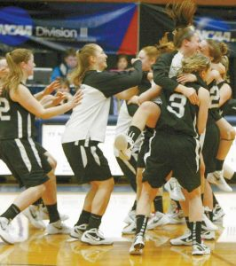 BOWDOIN COLLEGE women's basketball players react after beating Ithaca on Saturday to advance to the NCAA's Division III Sweet Sixteen.