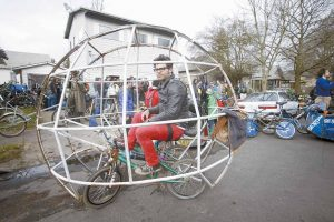 "ZANE FISCHER SITS in his hamster ball bike before a ""Ben Hurt"" chariot race during the three-day ""Mini-Bike Winter"" contests in Portland, Ore."