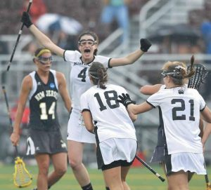 BOWDOIN COLLEGE'S Celeste Swain (4), here celebrating a Final Four semifinal victory over the College of New Jersey last year, and her Polar Bear teammates get into NESCAC action on Saturday at Ryan Field against Connecticut College. The teams play their season openers at noon.