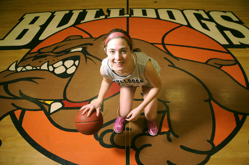 AT THE POINT: Kristina Buck is the starting point guard for the Hall-Dale High School girls basketball team, which will play in its second straight Class C title game Saturday.