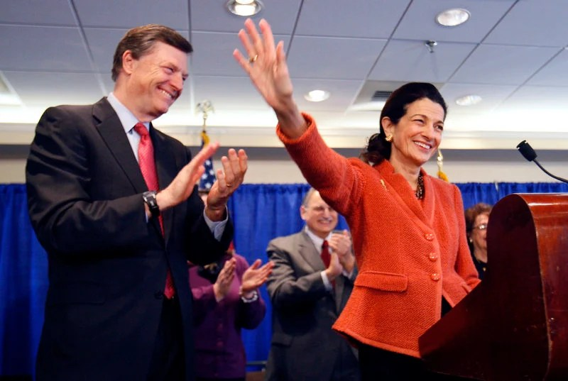 Sen. Olympia Snowe, R-Maine, accompanied by her husband, former Maine Gov. John McKernan, waves goodbye at the end of a news conference Friday in Portland. Her decision not to seek re-election to a fourth term in the U.S. Senate has transformed the state and national political narratives going into November's election.