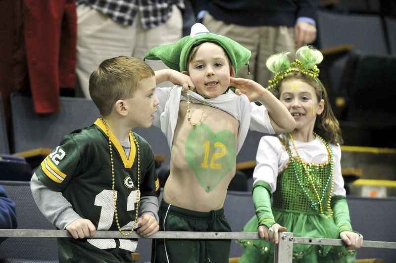 The young fans for McAuley were quick to show their support for their favorite player – senior Sadie DiPierro, who wears No. 12. From left to right are Brett McCaffey, Seamus Jennings and Calli Jennings.