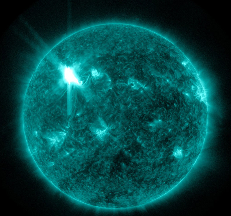 This extreme ultraviolet wavelength image provided by NASA enchances the depiction of a solar flare. A storm of charged particles from flares that erupted Tuesday night are hurtling toward Earth at 4 million miles per hour and are expected to hit today. Displays of northern lights could result.