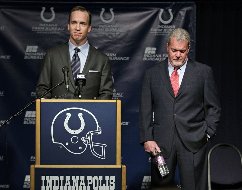Peyton Manning speaks as Colts owner Jim Irsay listens on Wednesday. Manning and the Colts parted ways after 14 seasons, leaving Manning as a highly sought-after free agent.