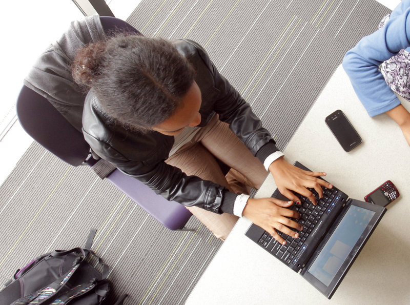 Fathia Elmi, a senior at Portland High School, uses a friend's netbook computer at the Portland Public Library.