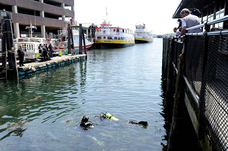 Members of the Portland police dive team search the waters near the State Pier on Monday, May 21, 2012 for a Harvard student who went missing after a night with friends in the Old Port.