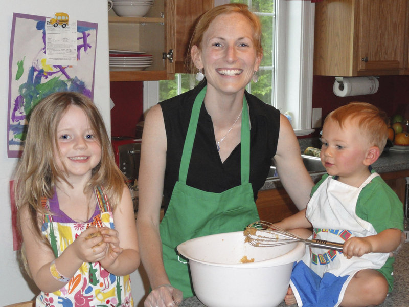 Erin Moulton cooks with her children Natalie and Cameron in her Windham kitchen.